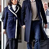 During a visit to Birmingham, Prince Harry wore a taupe sweater underneath a navy coat, which matched with Meghan's J. Crew piece.