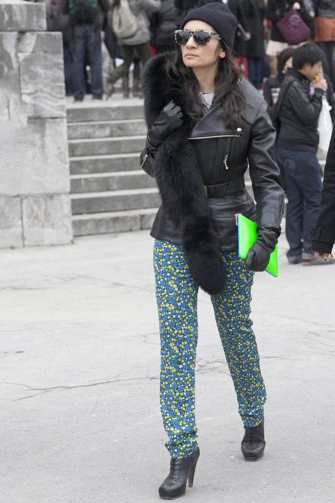 Printed pants and a neon clutch are key to pumped-up style.