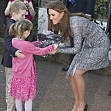 Kate beamed while getting flowers from children at the Hope House charity in London in February 2013.