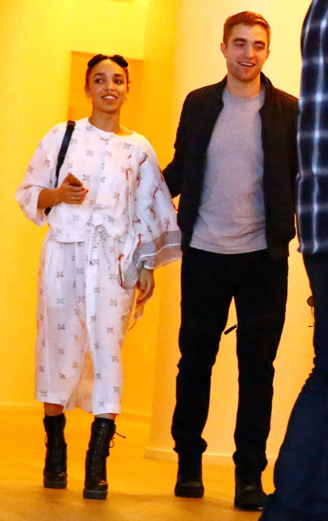 Robert Pattinson looked very much like a supportive boyfriend when he joined FKA Twigs in Miami on Thursday for her big events as part of Art Basel. The actor — who has shed the bizarre hairstyle that made headlines in November —showed PDA with his lover as they left a talk that FKA Twigs had taken part in for Surface magazine. Later, the British singer took over the stage at the YoungArts Campus to perform a short concert. The two stars are hardly the only celebrity couple that has popped up at the annual art festival. Miley Cyrus and her new beau, Patrick Schwarzenegger, have been heating up Miami since she performed a concert on Wednesday and put her new artwork on display. However, what has been getting the most attention from Miley's trip is the fact that she was spotted wearing nothing but silver pasties and matching tights while partying postconcert. Keep reading to see more shots from FKA Twigs and Rob's night in Miami.