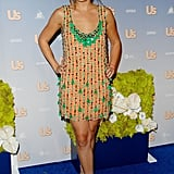 Lauren Conrad arrived at Us Weekly's 2007 Hot Hollywood party in a kelly-green-and-orange embellished mini. Lesson from Lauren: pair green with orange for an eye-catching color combo.