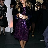 For a June 2012 party at the NYC MoMA, SJP donned an embellished magenta Oscar de la Renta dress with lilac satin Manolo Blahnik pumps, then layered a blue velvet blazer and Fred Leighton jewels for extra flair.