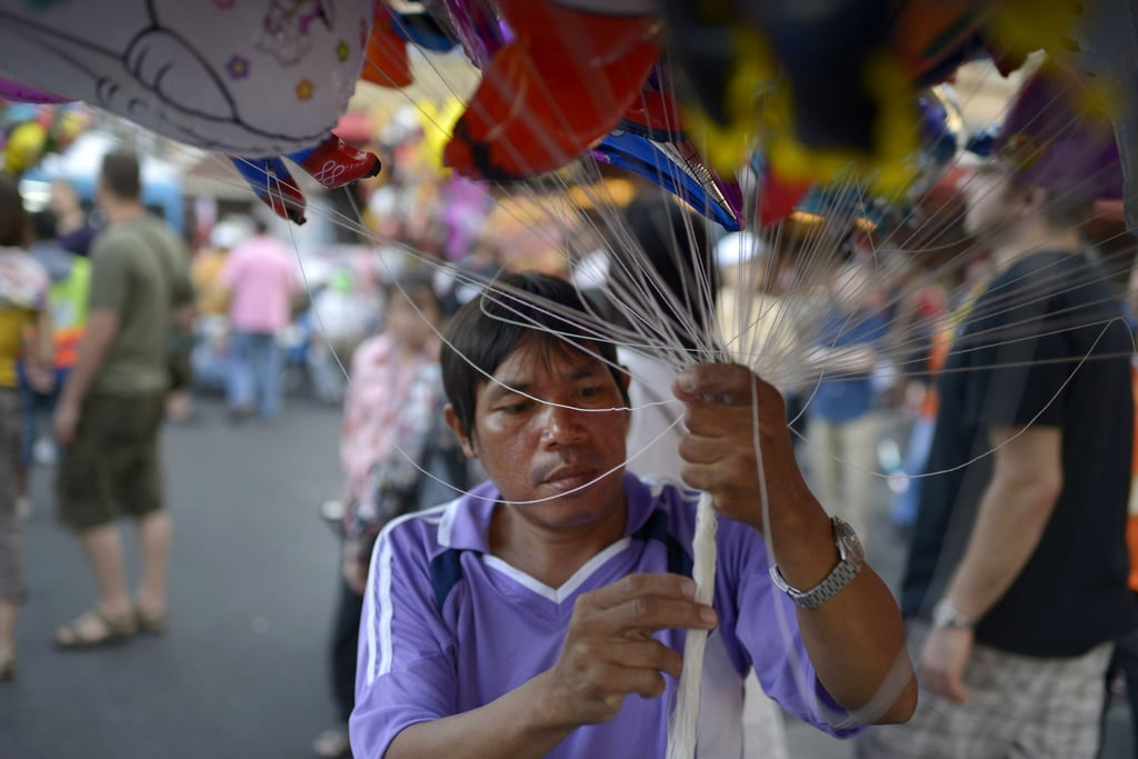 A man sold balloons on the streets of Bangkok, Thailand, for the Chinese New Year celebrations.
