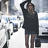 Wear Your Favorite Sweatshirt With a Denim Skirt and Fishnet Tights