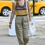 We love Ali Larter's beachier approach to Summer pants styling — flat sandals, bright stripes, and a complementary pant hue work very well together.