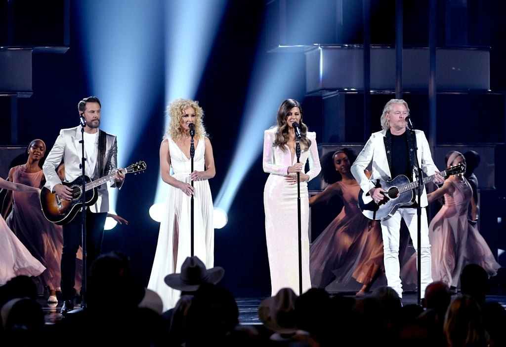 "Academy of Country Music Awards host Reba McEntire wasn't the only woman to call out country music's glaring gender imbalance at the big show on Sunday night; Little Big Town turned their entire performance of ""The Daughters"" into a bold, emotional statement calling for change. Dressed in matching all-white outfits, the quartet performed their new ballad that uplifts young women by calling out the burdens they're are so often forced to carry by society. As the band belted out lyrics like, ""And pose like a trophy on a shelf / Dream for everyone but not yourself,"" and ""I've heard of God the Son and God the Father / I'm still looking for a God for the daughters,"" they were joined by a female contemporary dance troupe who showed off a stunning routine that perfectly represented the song's message.      Related:                                                                                                           ACM Awards: Keith Urban's Heartbreaking Performance of ""Burden"" Will Stop You in Your Tracks               Toward the end of Little Big Town's performance, singer Karen Fairchild got choked up, struggling to hold back her tears as she sang. In the audience, musician Brandi Carlile was also openly emotional, wiping away her tears as the band finished up the track. Watch their performance of ""The Daughters"" for yourself ahead, and then keep reading to see some beautiful photos of the band with the dancers who accompanied their set."