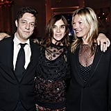 Carine Roitfeld cuddled up inside the CR Fashion Book party with Jamie Hince and Kate Moss.