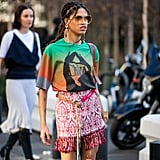 Go bold and pair a graphic tee with a printed miniskirt.