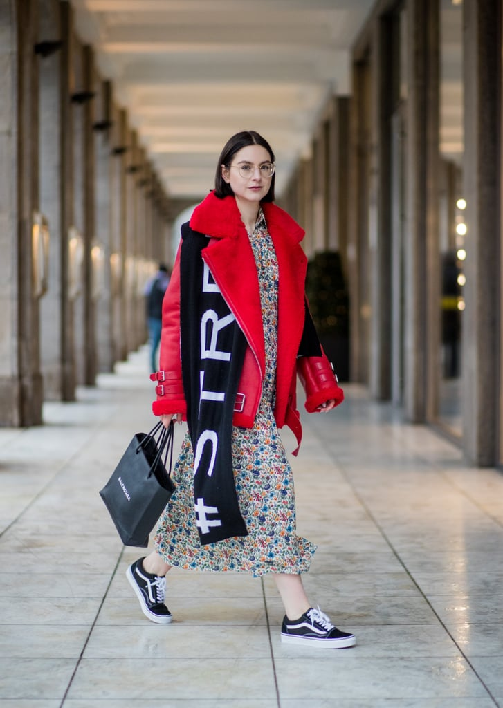 With a Bold Shearling Leather Jacket, Floral Dress, and Logo Scarf