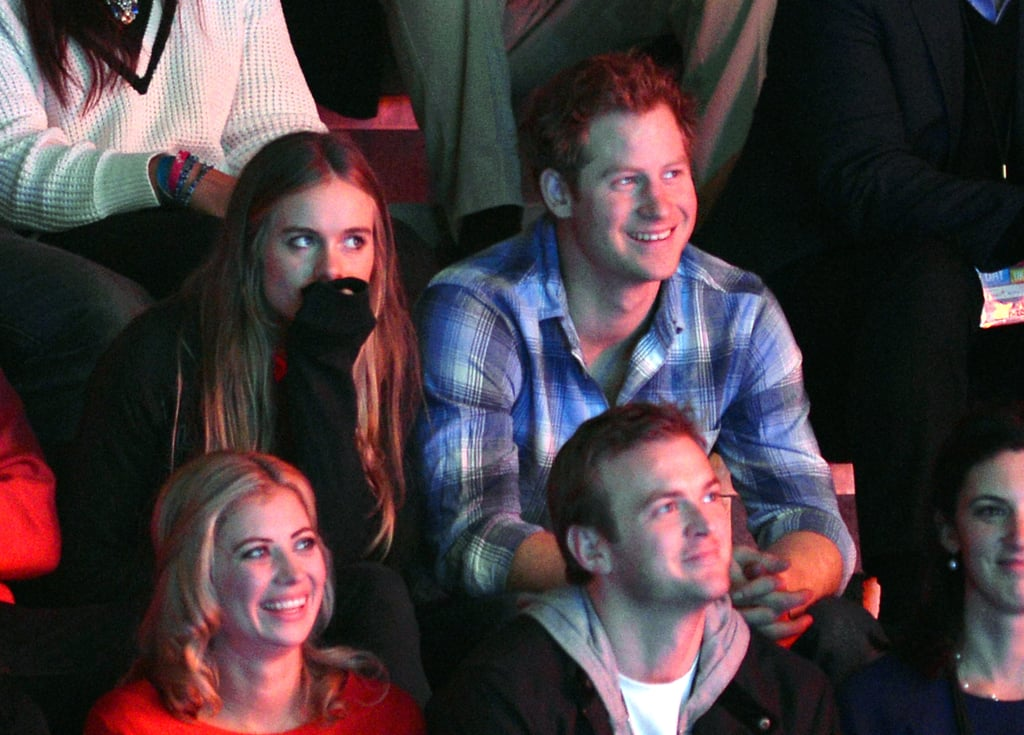 Prince Harry and his girlfriend, Cressida Bonas, got cozy at the We Day UK charity event at Wembley Arena in London.