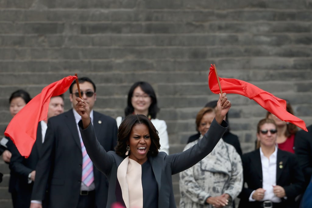 First Lady Michelle Obama waved flags during her visit to Xi'an.