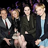 Laura Carmichael, Michelle Dockery, and Michelle Williams smiled with Tom Hiddleston.