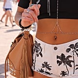 Nasty Gal jewelry was both dainty and sexy atop these palm-tree-print cutoffs.