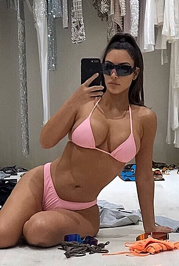 Kim Kardashian in a Pink Bikini Packing For Cabo San Lucas