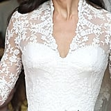 A purported team of 60 worked on the hand-embroidered lace on Kate's dress.