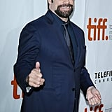 John Travolta gave a thumbs-up at the premiere of The Forger.