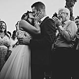 """""""This capture is our personal favorite of the year because it was truly the first time we witnessed the joining of two lives surrounded by and consumed by their loving family and friends. It was not about being up on a stage for everyone to observe, it was about a commitment between two souls and two families, together. Photos can only capture so much, but when we look at this photo it seems to tell a story that is deeper than words."""" — Aubrey Westlund"""