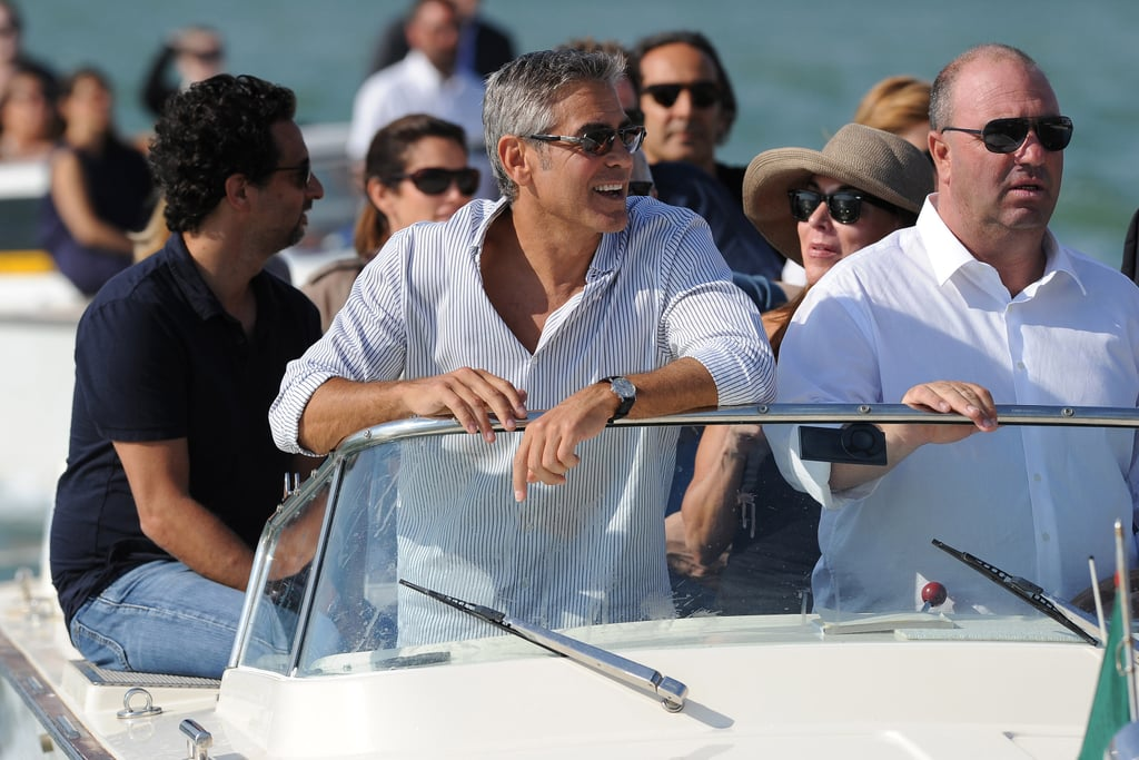George Clooney waved to fans as he arrived in Venice by boat this afternoon. He's just in time for the city's film festival, which features The Ides of March as the opening movie. George wrote, directed, and starred in the film alongside Ryan Gosling, Evan Rachel Wood, and Marisa Tomei. Ryan is also expected to attend the world premiere tomorrow. George and Ryan have the support of George's pals, Cindy Crawford and Rande Gerber, who were also along for the ride with George today. George hosted Rande, Cindy, Marisa, and Evan at his Lake Como home over the weekend, and even Bono put in a shirtless appearance. George is the first star to show up for the festivities, which will also hopefully bring out Kate Winslet, Matt Damon, Matthew McConaughey, and others.