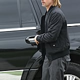 Brad Pitt was dropped off by a black SUV.