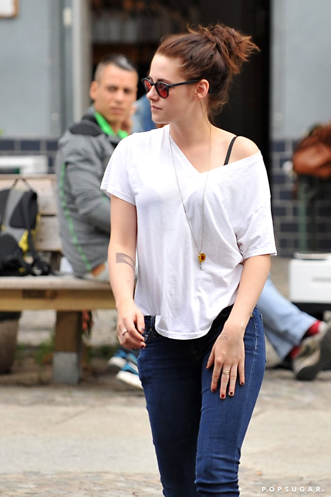 Kristen Stewart showed off her new tattoo while out and about in Berlin with friends.