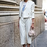 If you're sick of going for the typical LBD, swap it for white culottes. Edgy is an understatement.