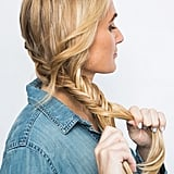 Once all the hair is over to one side, convert the plait into a fishtail.