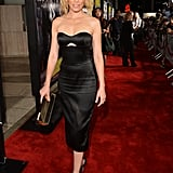 Elizabeth Banks furthered the drama of her premiere style with a pair of fashion-forward Jimmy Choo t-bar sandals to complement her Alexander McQueen strapless.