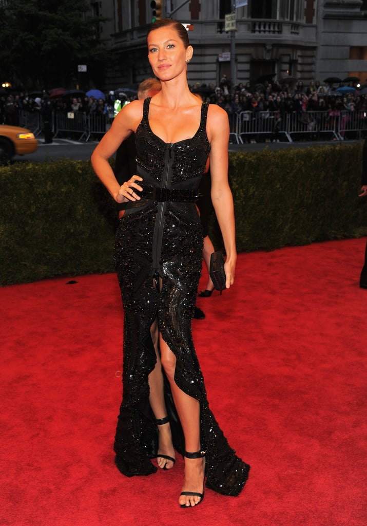 Gisele Bundchen wore a stunning Givenchy dress with a front slit on the red carpet at the Met Gala.
