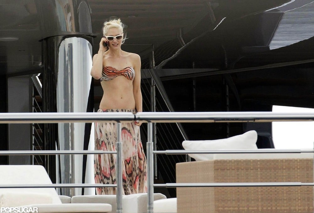 Gwen Stefani gabbed on her cell phone in a tiger-print bikini while on a yacht in France in May 2011.