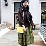 Juxtapose a Girlie Skirt With a Cool-Girl Beanie
