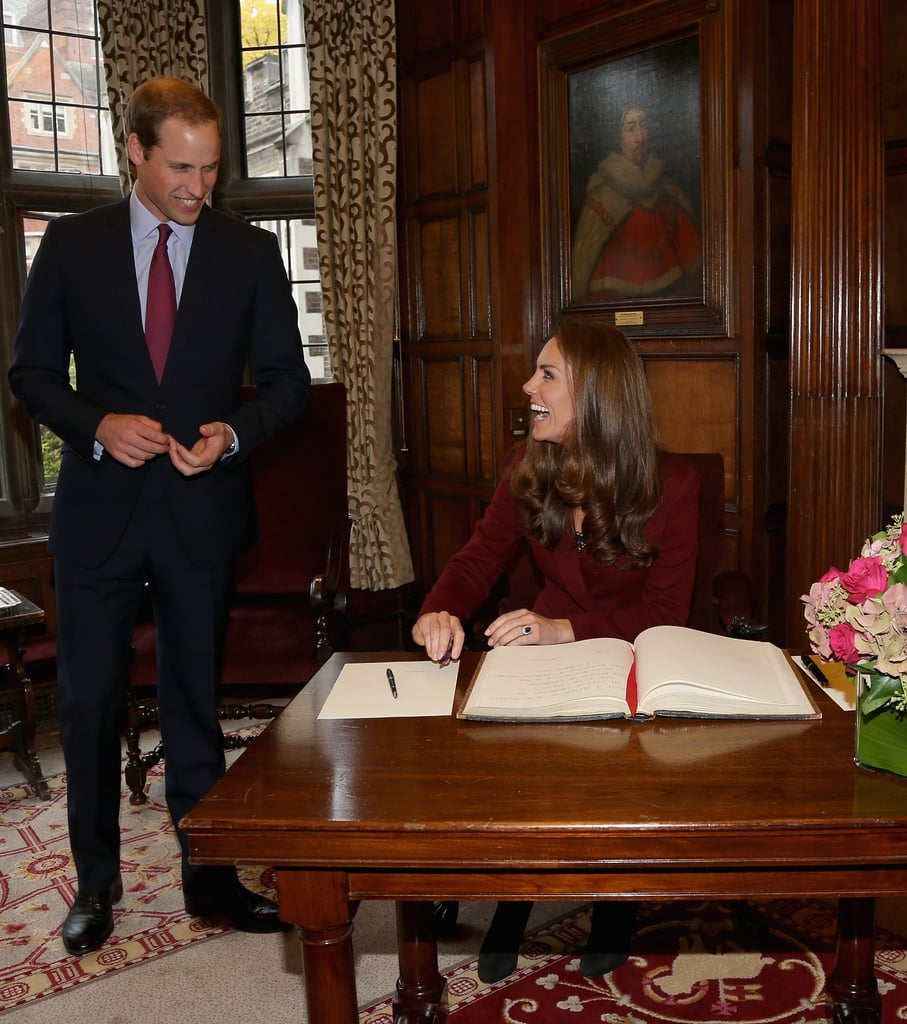 Kate Middleton and Prince William were all smiles as she signed the guest book during a visit to Middle Temple in London.
