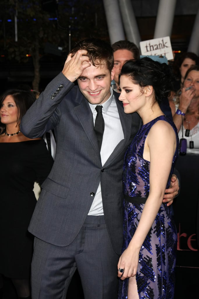 Robert Pattinson played with his famous hair.