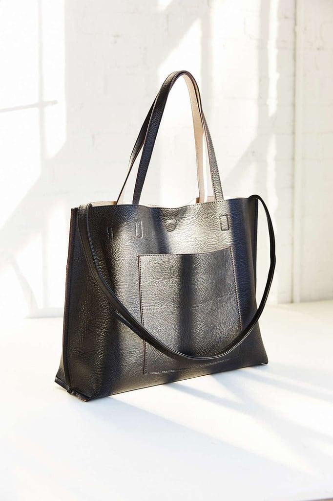 527b40e1b6b05 Urban Outfitters Reversible Vegan Leather Tote Bag ($59) | All Black ...