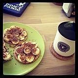 A morning snack of green tea and whole grain crackers topped with bananas, almond butter, and flax seeds is great fuel to start the day. Source: Instagram User cherimoya