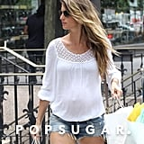 Gisele Bundchen had her hands full with bags.