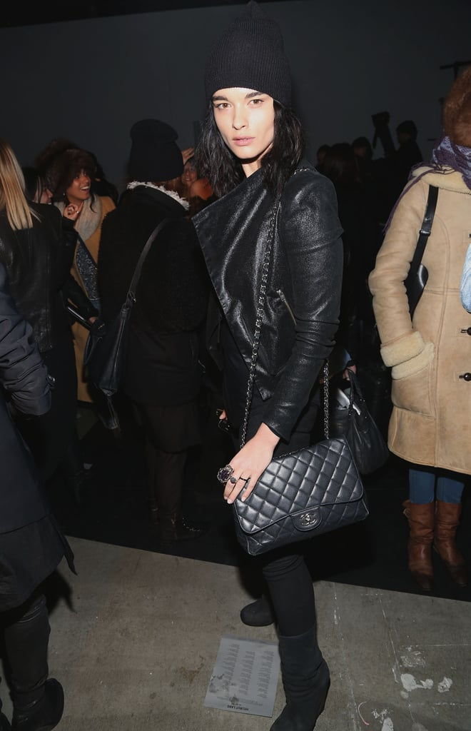 Model Crystal Renn looked slick in all black — leather jacket, beanie, and quilted Chanel purse — at Helmut Lang.
