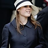 For the service which followed Prince Charles and Camilla's wedding, Eugenie wore a cream coloured hat with a navy ribbon.