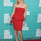 Charlize Theron walked the carpet in a head-turning red dress at the MTV Movie Awards.