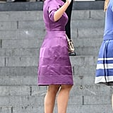 Princess Eugenie wore a purple Suzannah dress, Loro Piano bag and nude Kurt Geiger Gina shoes.