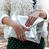 A metallic clutch was a stark contrast against a furry chubby.
