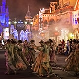 Dancers fill the streets.