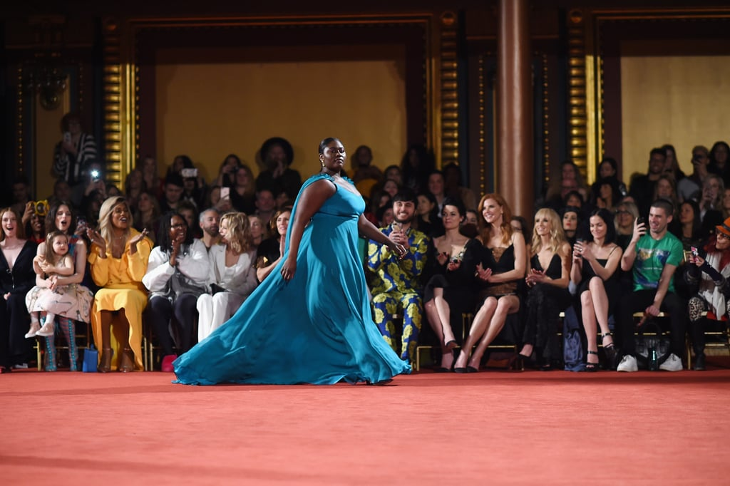 It might be several months before the release of Orange Is the New Black season six, but a recent reunion between two beloved cast members is tiding us over. During New York Fashion Week, Danielle Brooks — who portrays Taystee Jefferson — walked in Christian Siriano's runway show as her costar Laverne Cox — who plays Sophia Burset — cheered her on from the front row.  In pictures from the show, you can see Laverne clapping, smiling, and whipping out her phone as Danielle took the runway in an ethereal teal gown. The two then reunited backstage and posed for some sweet shots with the designer, as well as legendary stylist Patricia Field. See all the heartwarming pictures ahead.