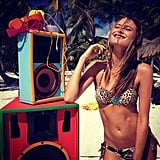 Behati Prinsloo listened to some tunes on the beach this week.  Source: Twitter User BeePrinsloo