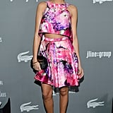 Ashley Madekwe's pink floral J. Mendel crop top and A-line skirt splashed the gray carpet with major colour. Matching strappy hot-pink sandals and a black clutch completed her eye-catching style.