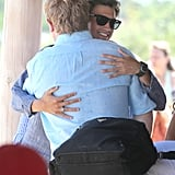 David Burtka greeted Elton John with a hug.