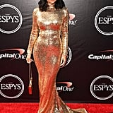 Kylie chose a gold turtleneck gown by Lebanese designer Shady Zeineldine. She completed her look with a matching chain-strap handbag.