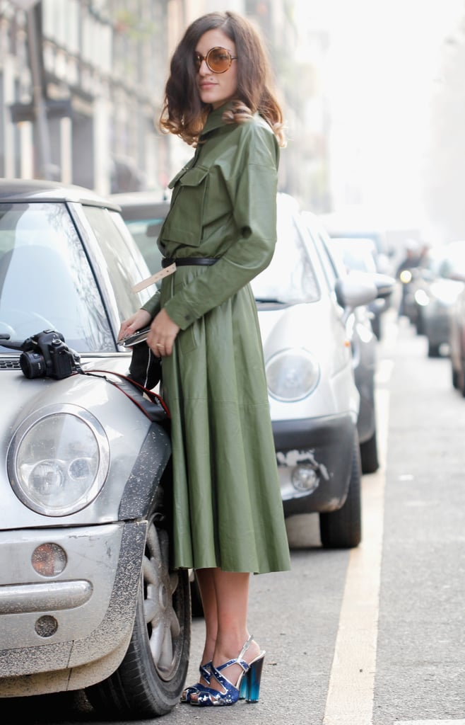 This styler upgraded her street-chic shades with an olive-hued trench coat and statement heels.