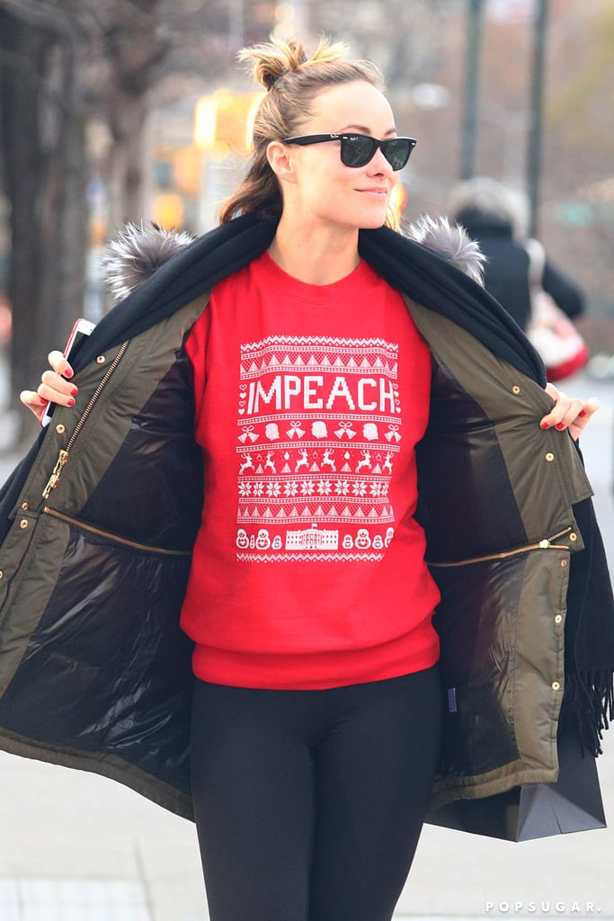 "Olivia Wilde was spotted out and about in NYC on Wednesday wearing her holiday best — with a political twist. The actress and mother of two was photographed gleefully showing off her Christmas sweater, which, in addition to having ""IMPEACH"" written across it, also featured tiny Donald Trumps, a hand-stitched White House, and Russian Matryoshka dolls. If this isn't a damn 2018 mood, we don't know what is. Keep reading to see Olivia's statement-making sweater, then see who we'd be left with should an impeachment actually happen."