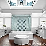 Giuliana and Bill have a two-story bathroom and dressing room. The spaces are unified by teal Bernhardt chairs on the upper floor and matching Walker Zanger tiles below.