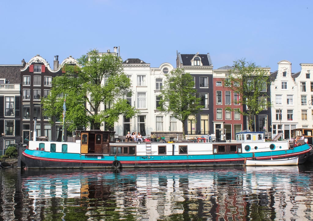 I mean, does it get any dreamier than a colorful houseboat resting calmly on the serene waterway? I don't think so.